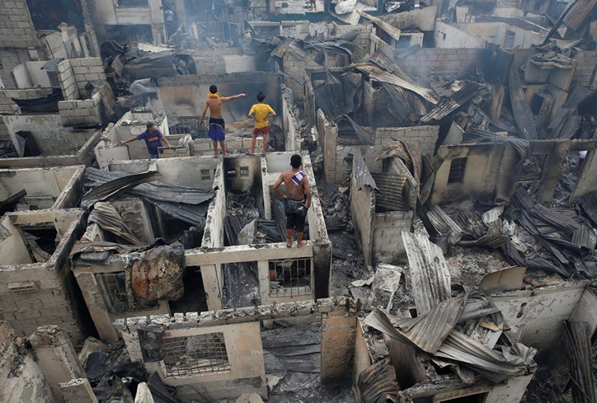 Сгоревший дом в одном из районов Манилы, Филиппины.
