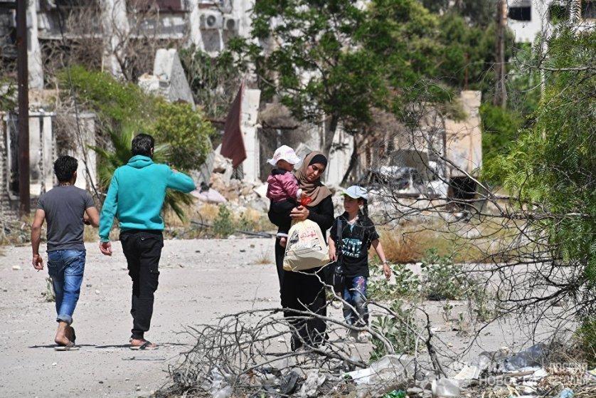 Жители на улице в Кабуне.