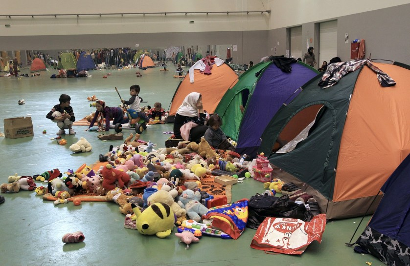 epa05011378 Refugee kids play with toys offered by volunteers outside their tents inside the Galatsi Olympic Hall in Athens, Greece, 04 November 2015, which is used by refugees who arrive from the islands as a temporary shelter before continuing their journey to central Europe. Europe is dealing with its greatest influx of migrants and asylum seekers since World War II as immigrants fleeing war and poverty in the Middle East, Afghanistan and Africa try to reach Germany and other Western European countries - many of them via Greece.  EPA/SIMELA PANTZARTZI