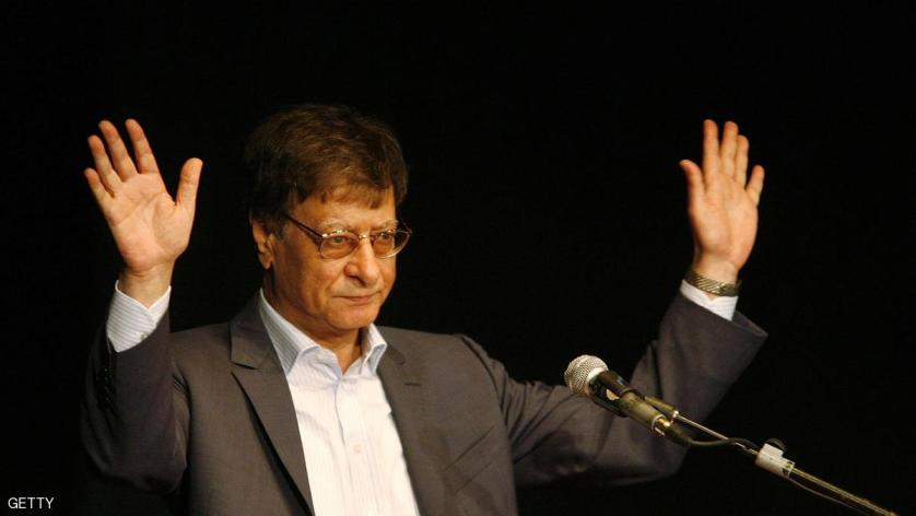 HAIFA, ISRAEL - JULY 15:  Palestinian poet and journalist Mahmoud Darwish reads during his poetry show July 15, 2007 in Haifa, Israel. Darwish, seen as a symbol of Palestinian nationalism, made his first appearance in Israel on Sunday since his self-imposed exile from Israel, where he lived until 1971.  (Photo by Gil Cohen Magen-Pool/Getty Images)