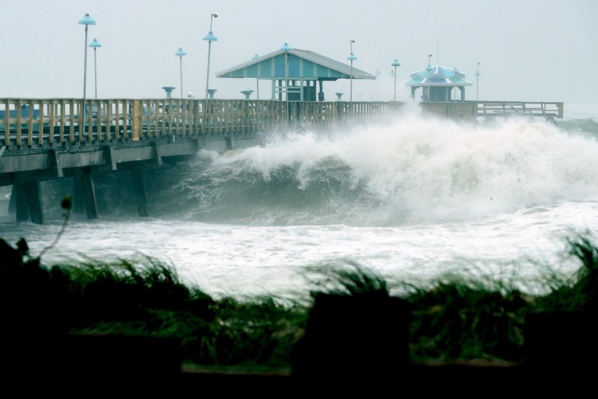 FORT LAUDERDALE, FL - SEPTEMBER 10: Large waves produced by Hurricane Irma crash into the end of Anglins Fishing Pier September 10, 2017 in Fort Lauderdale, Florida. The Category 4 hurricane made landfall in the United States in the Florida Keys at 9:10 a.m. after raking across the north coast of Cuba.   Chip Somodevilla/Getty Images/AFP