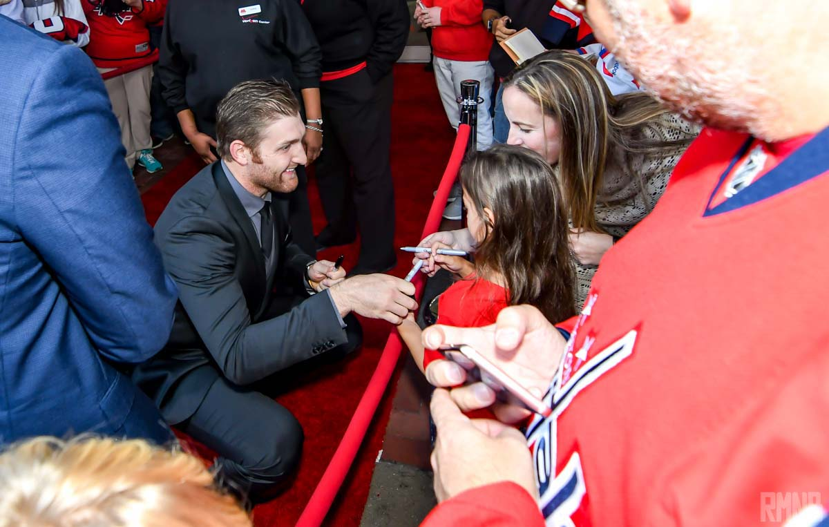 Karl Alzner meets with another one of his tiny fans