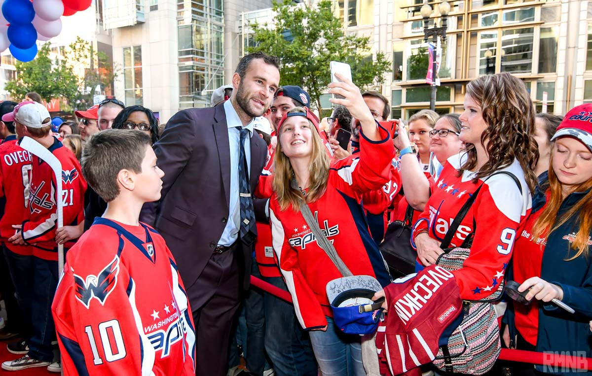 Connolly takes a selfie with fans