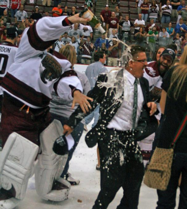 Neuvy gets champagne all over Doug Yingst!