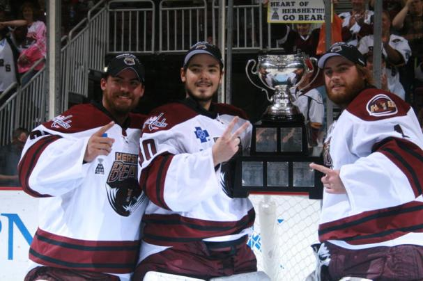 Neuvy celebrates his first championship, Holtby his first.