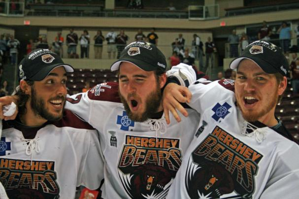 Mathieu Perreault, Francois Bouchard and Chris Bourque celebrate.