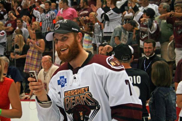 Karl Alzner takes out his flip camera to record the celebration!