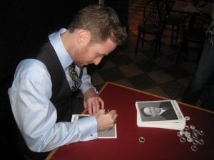 A bearded Jenkins signs autographs for fans during a Fan Club event.