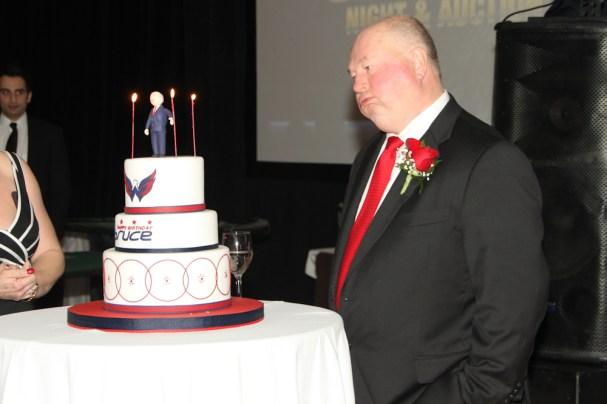 Bruce Boudreau admires his cake lustfully
