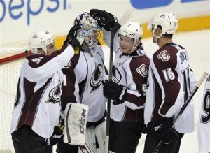 Varly's teammates congratulate him on the win. (Photo credit: Nick Wass)