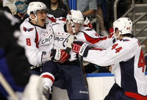 Alex Ovechkin and Jason Arnott celebrate with Alex Semin after his game-tying goal in the third. (Photo credit: Mike Carlson)