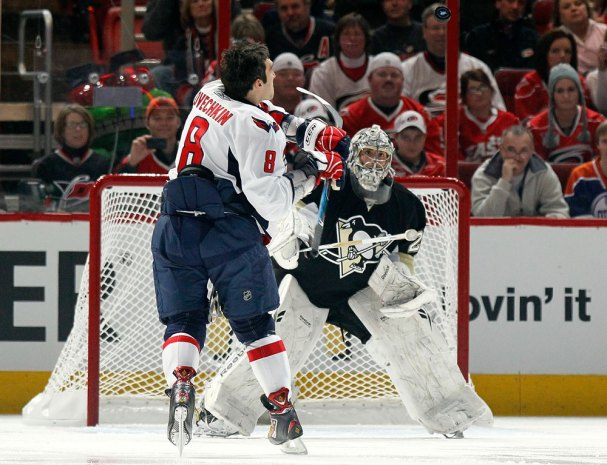 Alex Ovechkin swings at the puck