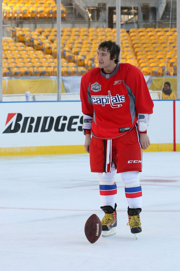 Alex Ovechkin spins the football on the ice