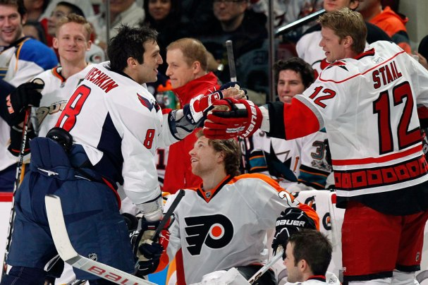 Alex Ovechkin gets a high-five from Eric Staal