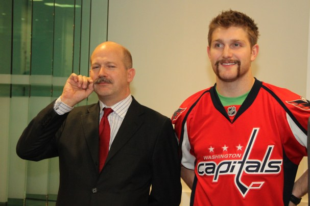 Alzner and Chilcott pose for a photo.