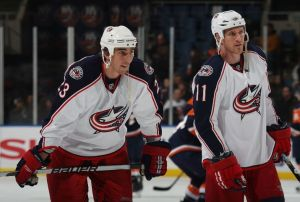 Chris Clark and Milan Jurcina in a Blue Jackets Uniform