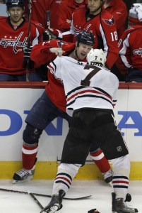 Jason Chimera brings the intensity in a second period fight with Brent Seabrook. (Photo credit: Jacquelyn Martin)