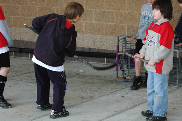 kids-play-hockey-with-shopping-cart