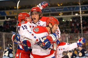 Ovi tackles his teammates after Mike Knuble's second period goal.