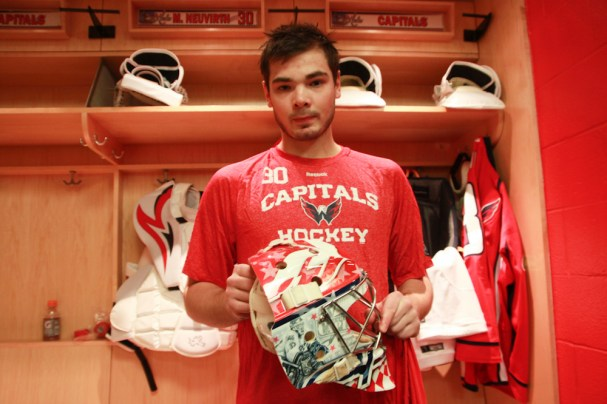 Michal Neuvirth holds up his new mask that has Olie Kolzig painted on the side
