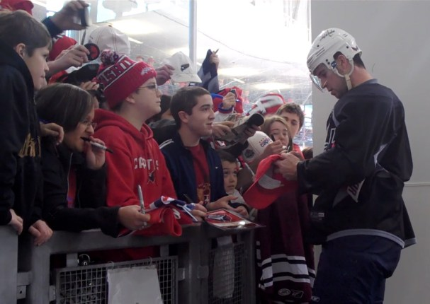 Mike Green signing autographs
