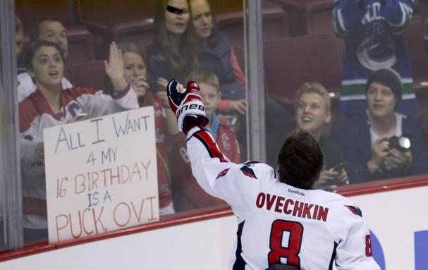 ovechkin-gives-puck-to-fan