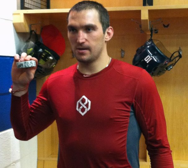 ovechkin-with-milestone-puck