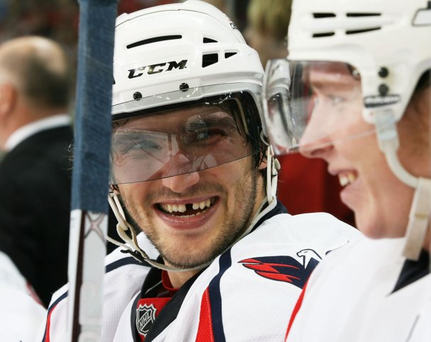 Alex Ovechkin and Nicklas Backstrom share a laugh on the bench.
