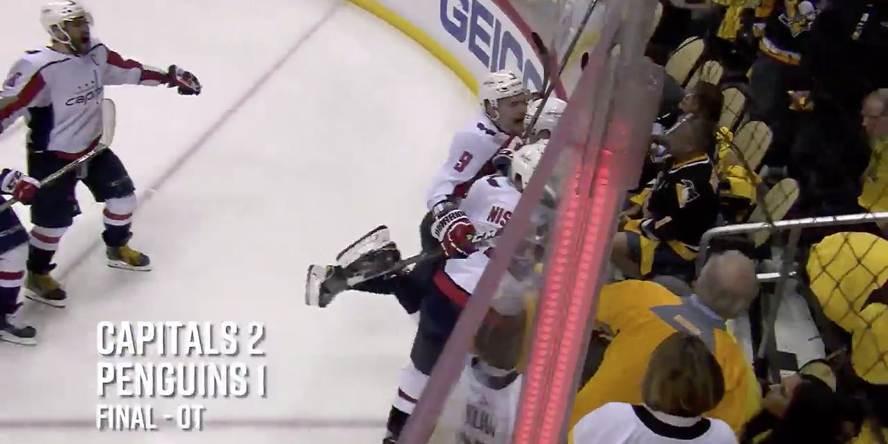 816196f428a The Capitals knocked over a Penguins fan while celebrating Evgeny  Kuznetsov s series-clinching goal
