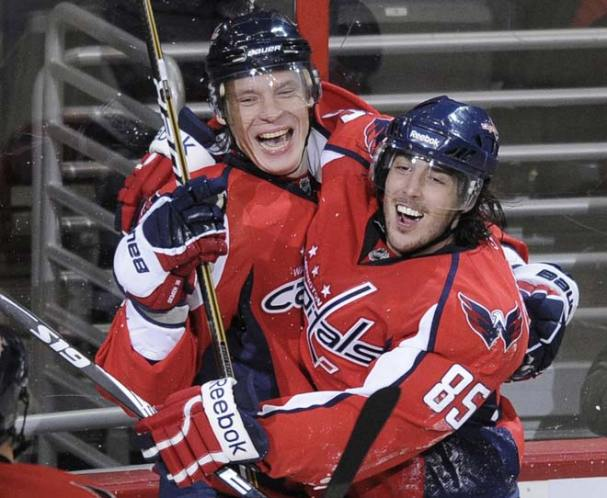 Alex Semin (3 goals) celebrates with Mathieu Perreault (two assists) after his 5th career hat trick.