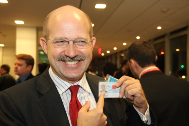 Chilcott comparers himself with the clean shaven version on his ID badge.