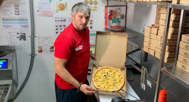 A nacho pizza, inspired by Alex Ovechkin's love of concession stand food, will be sold by Papa John's Russia