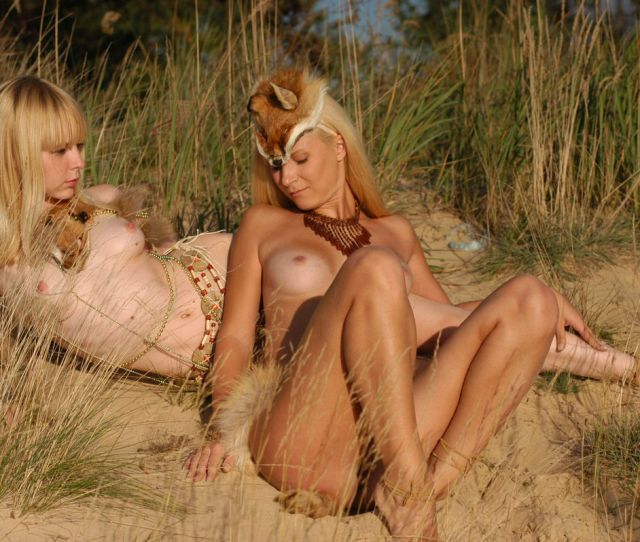 Young Naked Girls In Animal Costumes Posing By The River  Photos