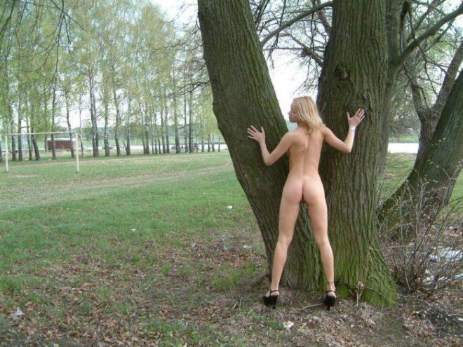Tattooed blonde Loli in nature