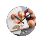 Raw ingredients for natural food in vintage style round clock