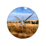 Rustic landscape from automobile round clock