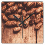 Pile of peanuts covering top half of board square wall clock