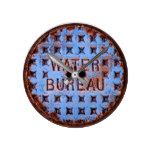 Water Manhole Cover. Rustic. California Round Clock