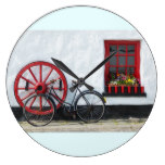 Whitewashed Donegal viilage pub with bicycle Large Clock