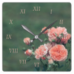Beautiful pink roses on a natural green background square wall clock