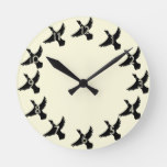 Yellow Silhouette Flying Duck Round Clock
