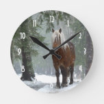 Brown Horse in a Winter Forest with Snow Falling Round Clock