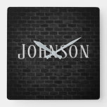 illuminated brick wall with family name square wall clock
