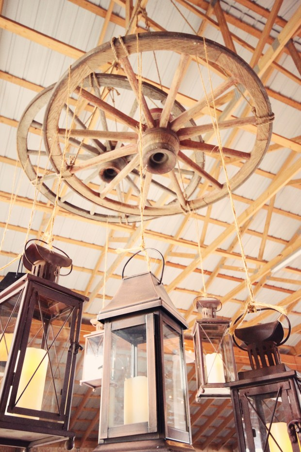 Lanterns hung from wagon wheels on the ceiling