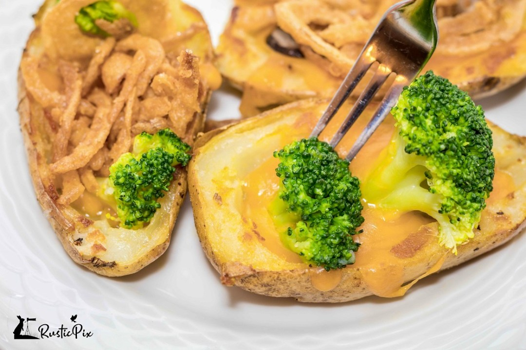 stuffed potato skins cheese broccoli with fork