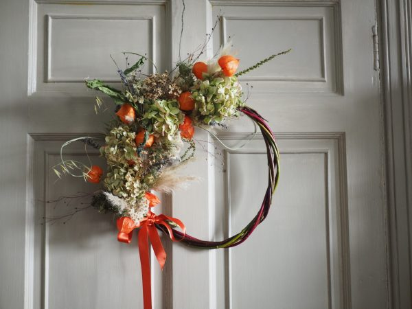 A jolly willow wreath with chinese lanterns, lavender, hydrangeas, pampas grass and other seed heads and grasses