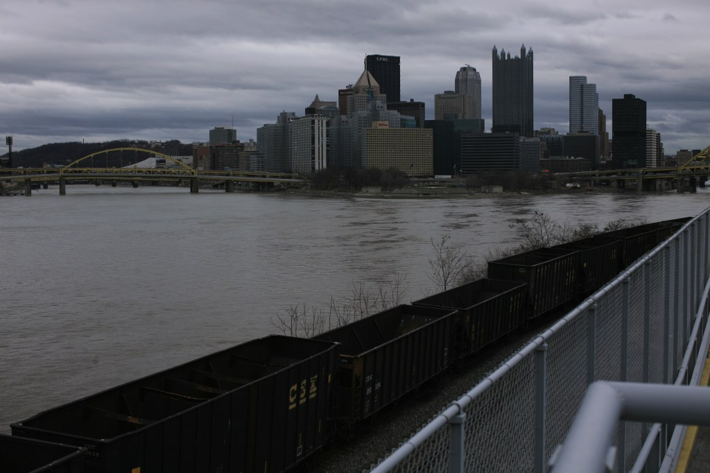 Pittsburgh Skyline and Rivers Beginning to Swell