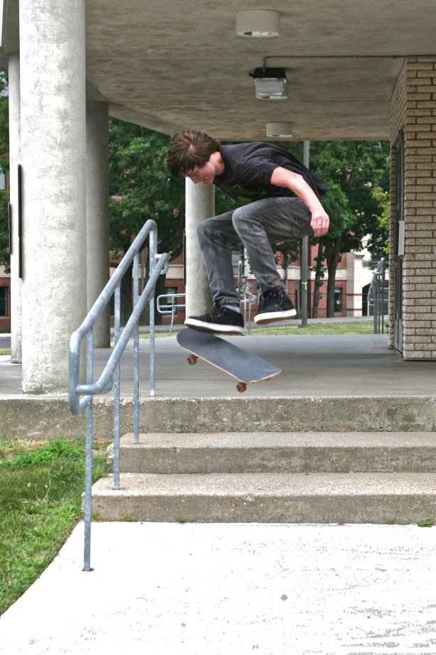 Way cool skateboarder jumping off stairs after a running start.