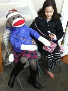 Anna and her Sock Monkey Take a Ride