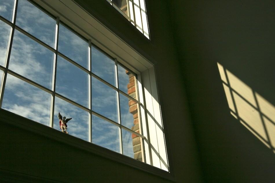 St. Michael Statue in a Sunny Window